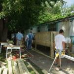 The Lansing, MI tuesday Toolmen Chapter prepare to build a wheelchair ramp for a client.
